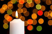 Candle light white with bokeh spots — Stock Photo