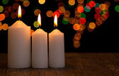Candle light closeup with bokeh three white — Stok fotoğraf