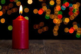 Candle light closeup with bokeh — Stockfoto