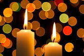 Candle light white with bokeh spots — Стоковое фото