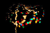 Bokeh heart spots of lights on background — Stock Photo
