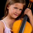 Girl holding violin in pink dress — Stock Photo