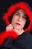 Portrait of sad woman in black cape and red fringe — Photo