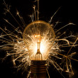 Light bulb with sparkles from behind — Foto Stock
