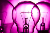 Row of light bulbs on a bright pink background — Stock Photo