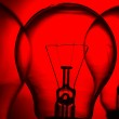 Row of light bulbs on a bright red background — Stock Photo #33438813