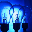 Row of light bulbs on a bright blue background — Stock Photo
