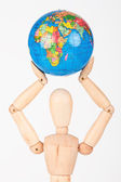 Brown wood mannequin holding concerned a globe protect — Stock Photo