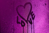 I love you written on condensation glass with purple light — Stock Photo