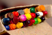 Crayons in a pack, the focus in the middle — Stock Photo