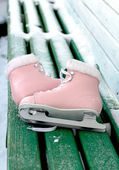 Skates on the bench — Stock Photo