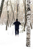Skier in the winter park, an old man — Stock Photo