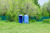 Toilet cabins in the park — Stock Photo
