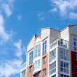 Condominium building against a blue sky — Stock Photo