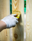 Man painting wooden furniture piece — Stock Photo