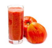 Glass of tomato juice with fresh tomatoes — Stock Photo