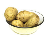 Raw potatoes on the plate — Stock Photo