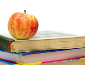 Apple on a stack of books — Stock Photo