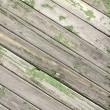 Green old wooden fence panels — Stock Photo #37344739