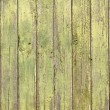 Green old wooden fence panels — Stock Photo #37344847