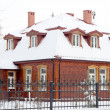 Wooden house in winter — Stock Photo #37591581