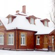 Wooden house in winter — Stock Photo #37591585