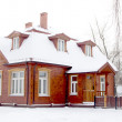 Wooden house in winter — Stock Photo #37591599