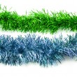 Christmas green and blue tinsel streamers — Stock Photo