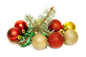 Christmas balls with fir-tree branch — Stock Photo