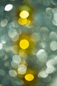 Holiday bokeh blurred on a dark background — Stock Photo