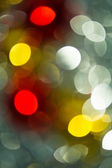 Holiday bokeh blurred on a dark background — Stockfoto