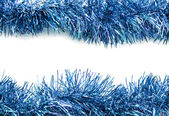 Christmas blue tinsel streamers — Stock Photo