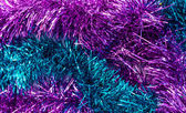 Christmas colored tinsel — Stock Photo