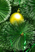 Christmas tree with golden ball — Stock Photo