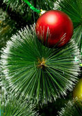 Christmas tree with red ball — Stockfoto
