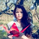Girl with origami crane — Stock Photo #25130783