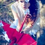 Girl with origami crane — Stock Photo #25130805
