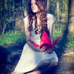 Girl with origami crane — Stock Photo #25130829