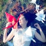 Girl with origami crane — Stock Photo #25130831