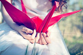 Girl with origami crane — Stock Photo