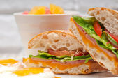 Ciabatta panini sandwich eggs tomato lettuce — Stock Photo