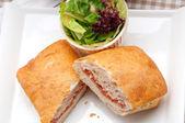 Ciabatta panini sandwich with parma ham and tomato — Stock Photo