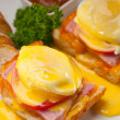 Stock Photo: Eggs benedict on bread with tomato and ham