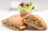 Italian ciabatta panini sandwich chicken — Stock Photo