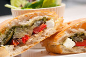 Ciabatta panini sandwichwith vegetable and feta — Stock Photo