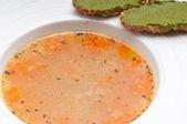 Italian minestrone soup with pesto crostini on side — Stock Photo