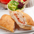 Ciabatta panini sandwich with parma ham and tomato — Stock Photo