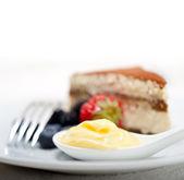 Tiramisu dessert with berries and cream — Stock Photo