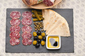 Cold cut platter with pita bread and pickles — Stock Photo