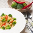 Italian penne pasta with broccoli and chili pepper — Stock Photo